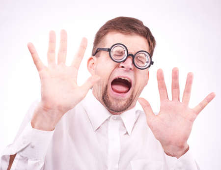 alarmed: Portrait of an afraid man in glasses Stock Photo
