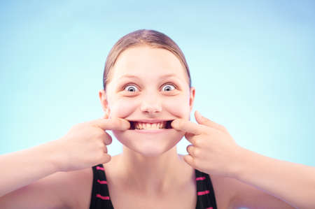 Funny silly teen girl grimacing Stock Photo