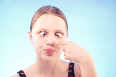 grimacing: Funny silly teen girl grimacing Stock Photo