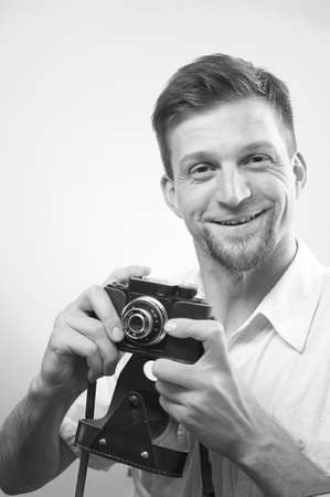 photojournalist: Professional photographer takes pictures with joy Stock Photo
