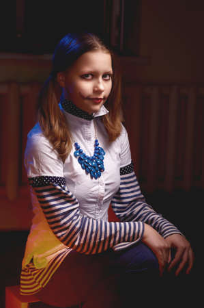 evil clown: Clown teen girl with a grin on her face