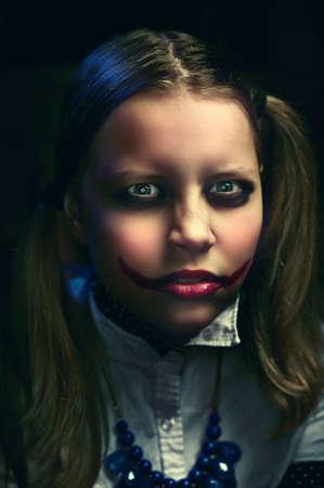 Evil clown teen girl looking at the camera Stock Photo
