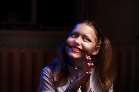 Clown teen girl with a sinister smile photo