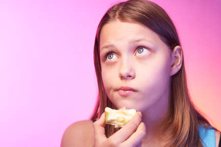 Portrait of an emotional funny teen girl eating apple