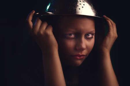 unbalanced: Sad depressed mentally unbalanced teen girl sits and cries Stock Photo