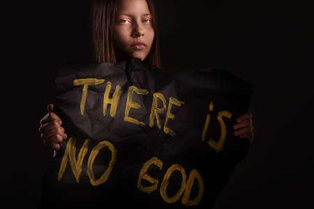 Atheist teen girl holding a banner with the inscription-