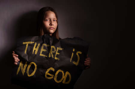 conflicting: Atheist teen girl holding a banner with the inscription-THERE IS NO GOD