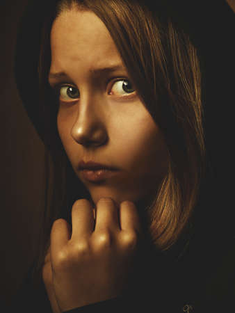 depressed teen: Portrait of a depressed teen girl. Pain and fear.
