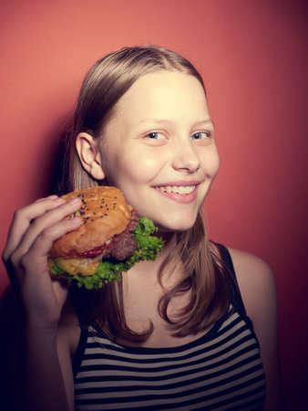 Teen girl with a delicious burger Stock Photo