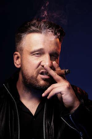 tough: Portrait of a tough guy smoking cigar