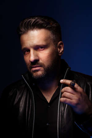 desperado: Portrait of a tough guy smoking cigar