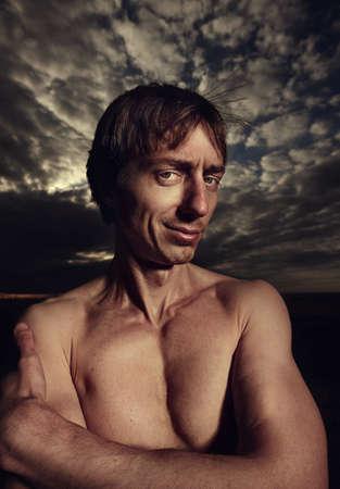 psychopath: Portrait of a psycho man on a cloudy background