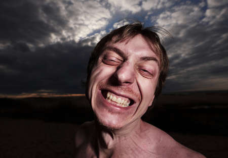 Portrait of a psycho man on a cloudy background