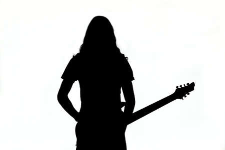 bass guitar women: Silhouette of a young man or girl playing guitar  Isolated photo on white background