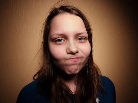 disgust: Beautiful young woman with sad face expressing disgust.