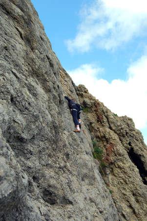 conquers: girl rock climber conquers mountain