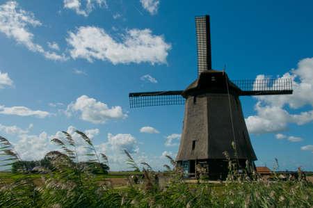 schermerhorn: Dutch windmill against a blue sky Stock Photo