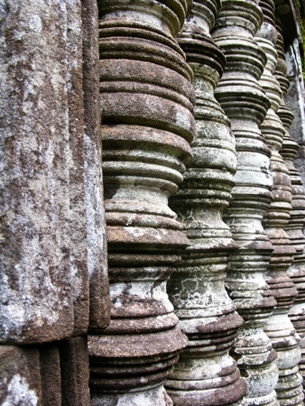 Stone window of temple in Vat Phou, Laos