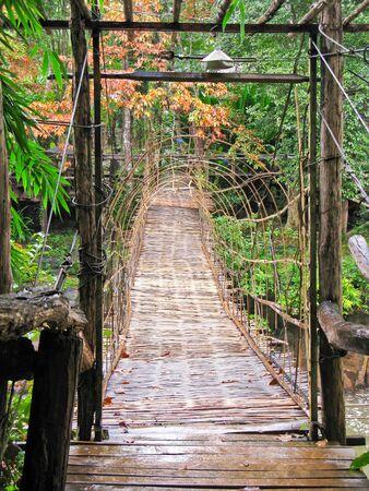 Hanging wooden bridge cross the river