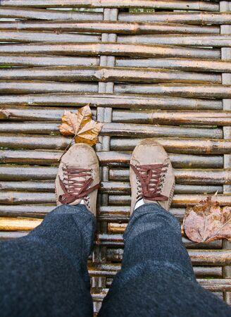 Feets walk over wooden bridge Stock Photo