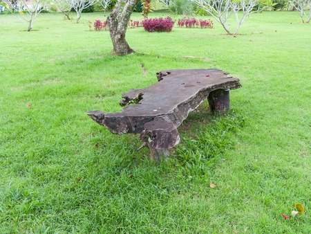 Stone bench on green field photo