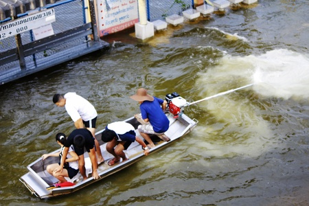 PATHUMTHANI, THAILAND - OCTOBER 16 : Unidentified people have to travel by boat on the road during flooding crisis, Pathumthani, Thailand on October 16, 2011. Stock Photo - 15227684