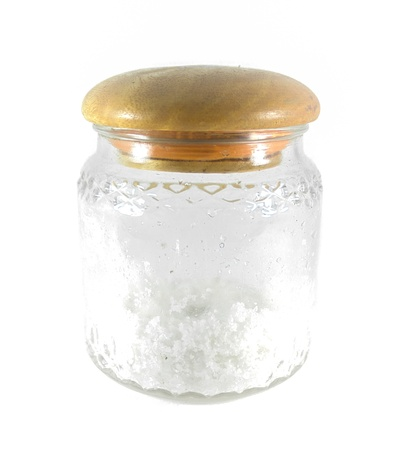 Salt in a glass jar with wood lid isolated