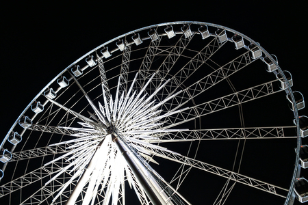 Ferris Wheel with lighting at night
