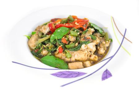 long bean: Thai spicy food, stir fried fish with basil, Pat-Ka-Praw-Pla Stock Photo