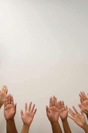 hands lifted: All people raise hands in the air Stock Photo