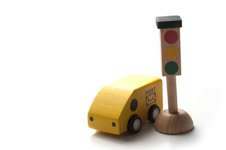 Little toy car and traffic light isolated on a white backgruond