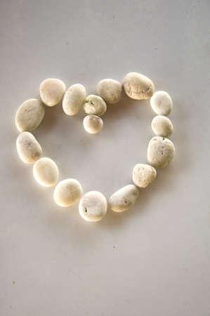 Stone heart isolated on white background