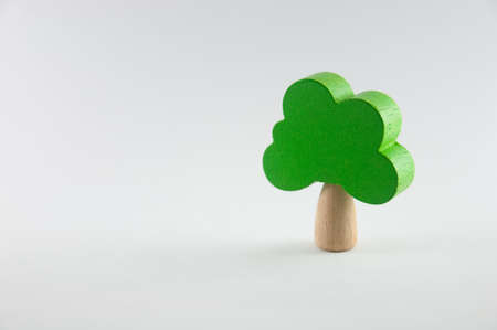 Green wooden toy tree on isolated white background Stock Photo