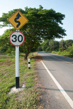 Curved Road Traffic Sign on a Rural Road