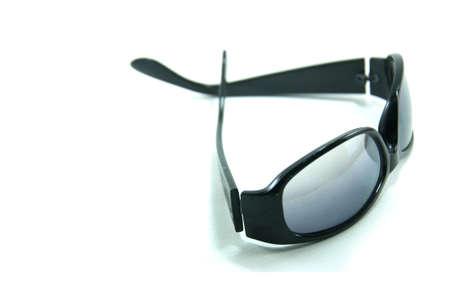 Modern sunglasses isolated on white photo