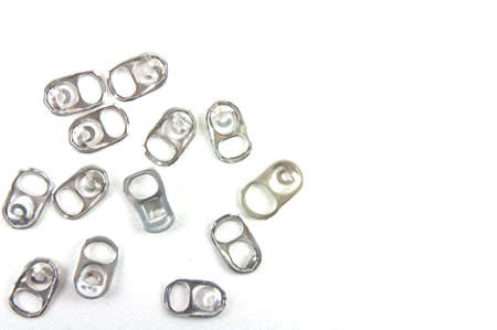 Recyclable aluminum pull-rings from soft-drink can. They can reduce the use of aluminum in manufacturing productions. for Global warming Stock Photo - 11064239