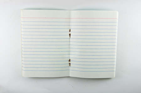 mini notebook on white background photo