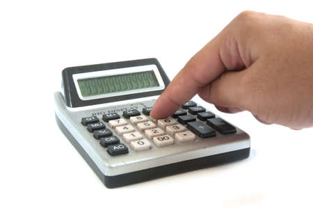 Male businessman using a calculator, closeup photo