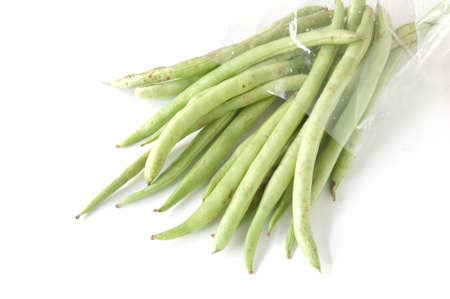 thai long bean in bag plastic on white background photo