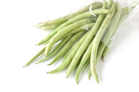 thai long bean in bag plastic on white background photo