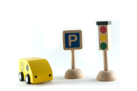 toy wood car ,symbol traffic light and symbol parking on white background