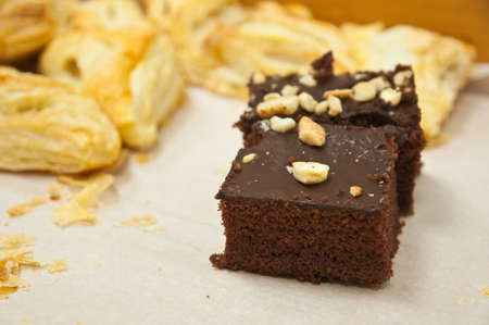 Fudge brownies with frosting and nuts photo