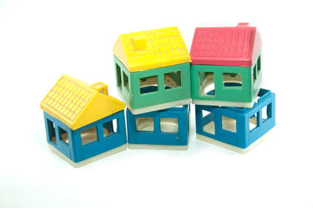 Toy house built by using colorful building blocks photo