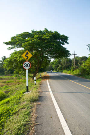 kilometre: Curvy road sign in Countryside road of Thailand