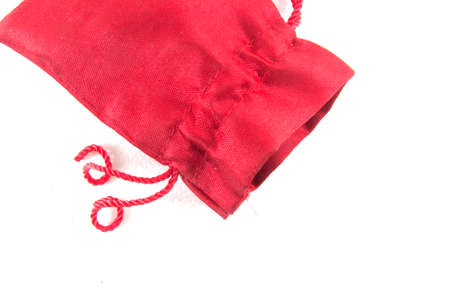 velure: Red velvet bag for gift`s and jewelery isolated on white