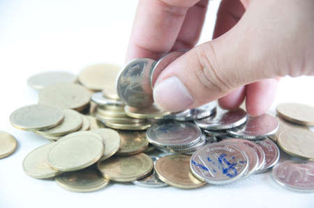 Money savings (a hand putting new money in the stack) Stock Photo - 12583501