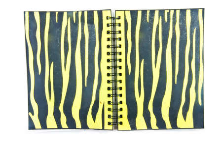 A streaked note book on white background photo
