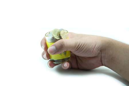 accrue: Money in the hand on white background