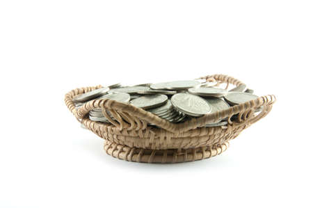 Thailand coins in basket bamboo on white background photo