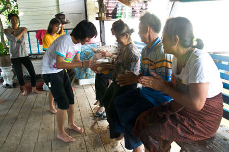 THAILAND - APRIL Thai people celebrate Songkran (new year  water festival: 13 April) by giving garlands to their seniors Bnagkok, Thailand.